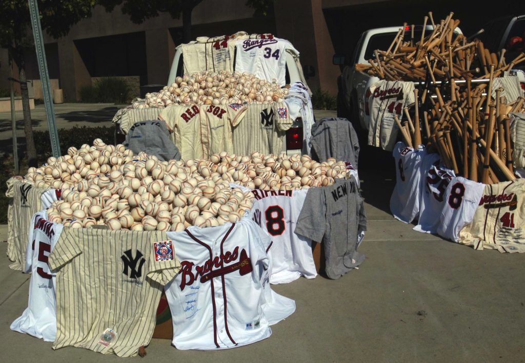 Some of the bats and balls donated by the FBI to youth leagues.