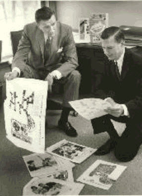 Fred Smart and F. Kent Mitchell, Post Products Division-General Foods, with 1961 Post cereal boxes in the background.