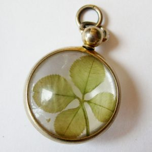 Vintage pendant with plant leaves embedded in transparent lucite