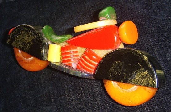 Brightly colored Catalin toy motorcycle
