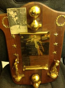 A 1958 retirement plaque given to Northern League President William White with newspaper clipping showing him holding the plaque, purchased from White's family. (Courtesy of Jason Christopherson)