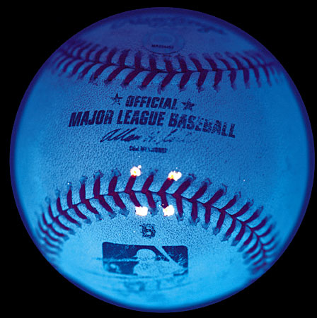 The black light marks on Barry Bonds' 600th home run ball auctioned by Legendary Auctions.  Major League Baseball placed the marks on the balls used during his at bats.