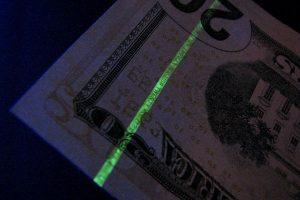 US Currency under black light