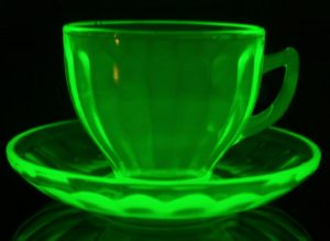 The popularly collected uranium glass fluoresces bright green under black light