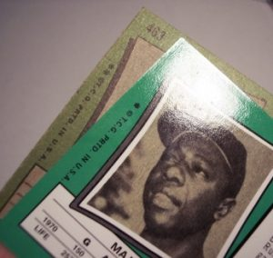 The reprint 1971 Hank Aaron has an different gloss (shiney) and coloring than the original card.