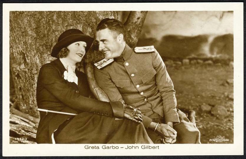 circa 1930 real photo postcard of movie stars Greta Garbo and John Gilbert. Movie star postcards have been collected by the public since the silent era.