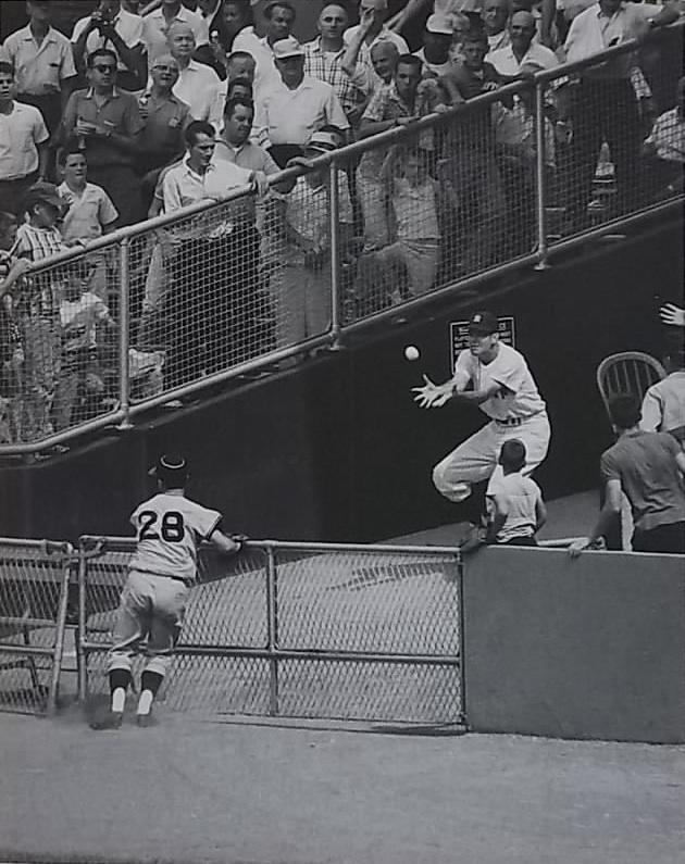 Yankee in the bullpen catching a Yogi Berra home run at Yankee Stadium.