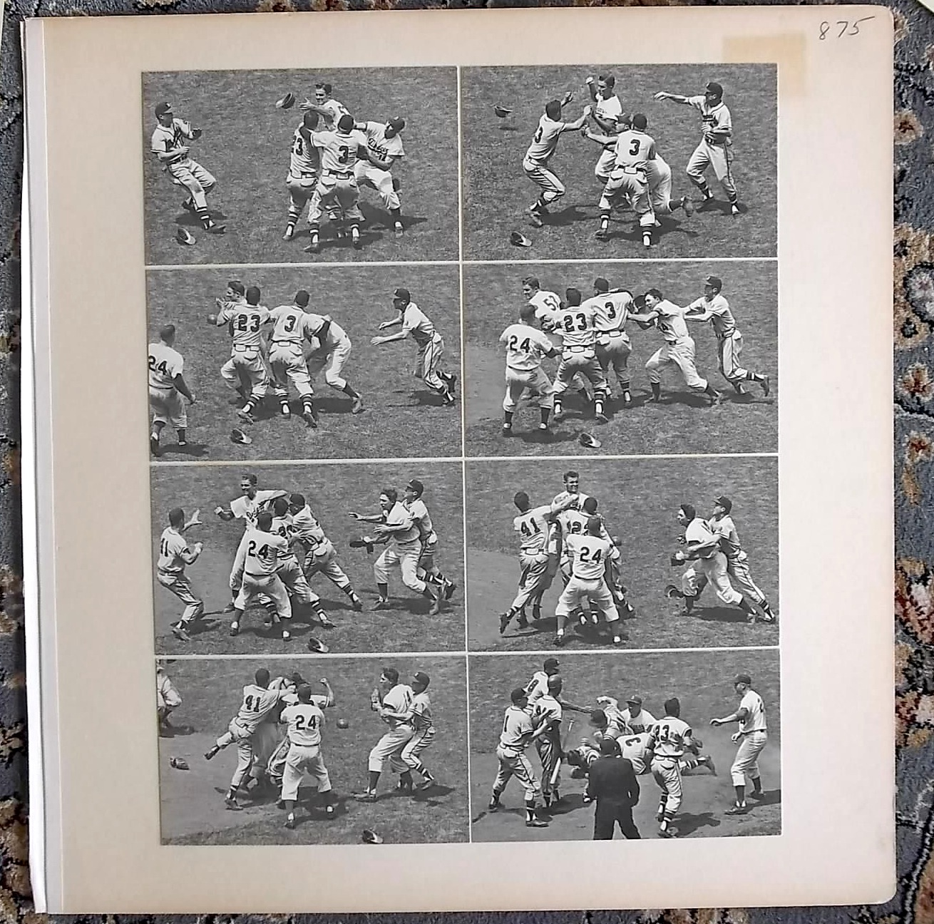 The same fight as shown earlier.  Some of the boards have composite images, with individual photos from a scene grouped together.