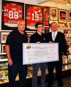 Cards2Kids founder John Makowiec accepts a $5,000 Upper-Deck scholarship.  Pictured L-R: Keith McDonough of Bleachers Sports Cards, John Makowiec and Upper Deck's Chris Carlin.