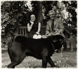 early 1960s of Price of Wales Edward VII and his American wife Wallis Simpson  showing their clear affection for their pug dog. The couple were famous pug fanciers.  The photo was taken by Patrick Lichfield, an official Royal and Vogue magazine  photographer and a Royal in his own right.  The photo's back has Lichfield's stamp for easy identification.