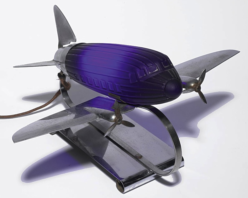 Wonderful antique metal and cobalt glass airplane