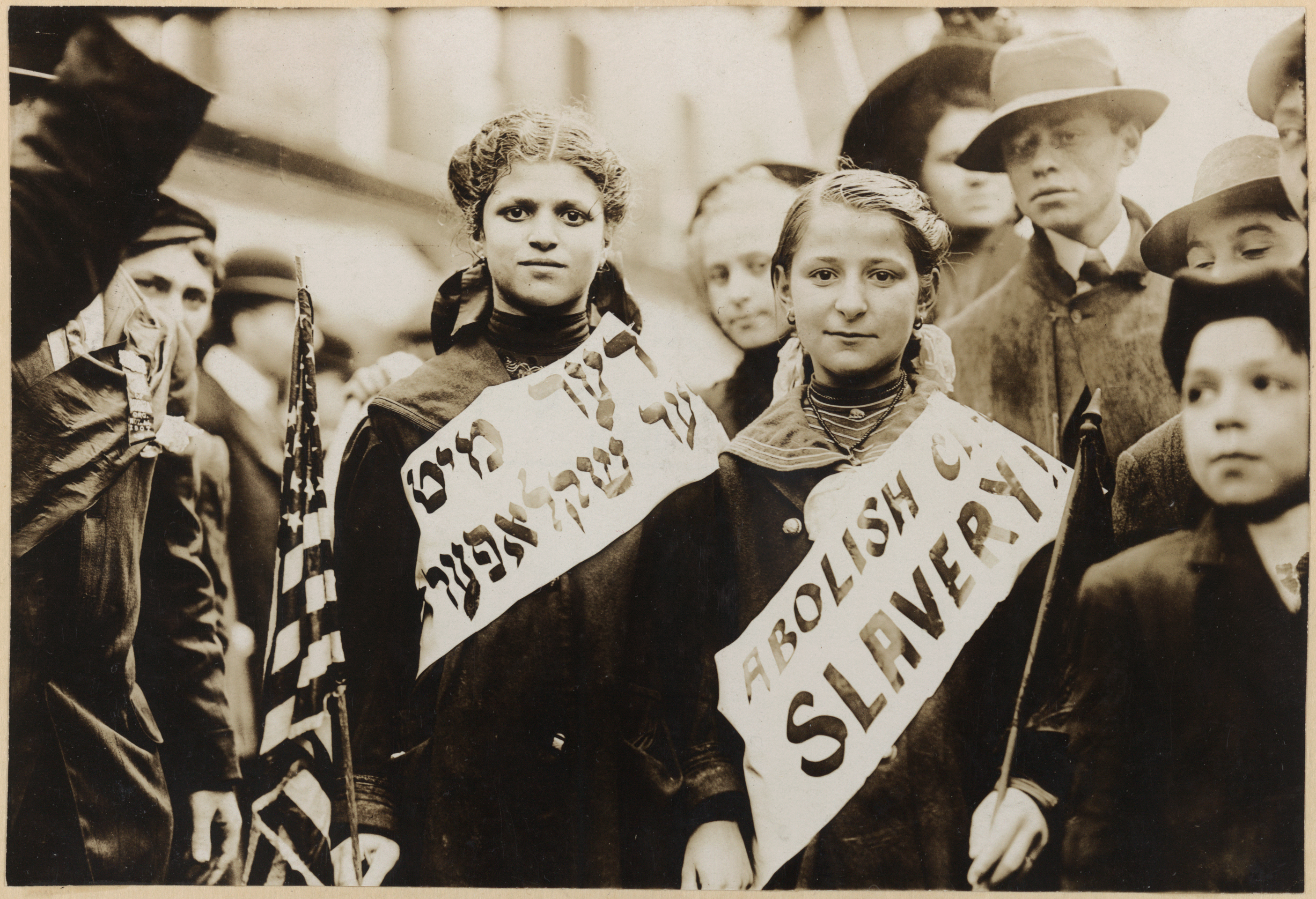 Young protesters against child slavery, with banners in English and Yiddish
