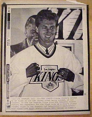 Laserphoto of Wayne Gretzky signing with the Los Angeles Kings. Laserphotos closely resemble wirephotos.