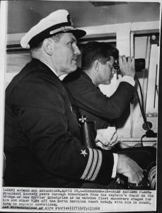 John F. Kennedy and Commander Harold Lang aboard an aircraft carrier in 1962