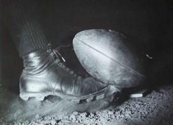 Wes Fesler kicking football