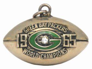 A genuine diamond on a genuine gold  antique football pendant