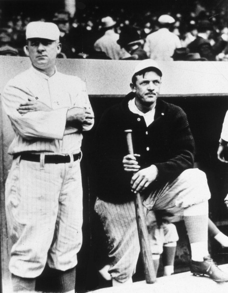 NEW YORK, NY - CIRCA 1908.  Christy Mathewson, right, and John McGraw, Hall of Fame pitcher and manager respectively for the New York Giants, pose on the dugout steps in the Polo Grounds before a game circa 1908 in New York CIty. (Photo Reproduction by Transcendental Graphics/Getty Images)