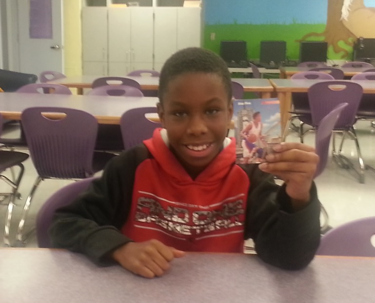 Elijah, a fifth grader at West Riviera Elementary, shows off a card of his favorite player, Reggie Miller.