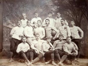 1879 Yale football team, with Remington bottom right and Walter Camp holding the ball