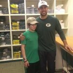 Jake Cohen and Aaron Rodgers