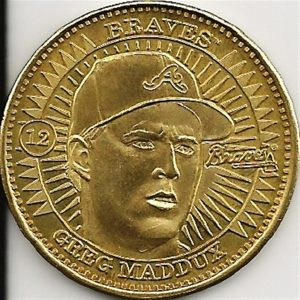 1998 Pinnacle Coin Greg Maddux.  Issued as inserts in their sports packs, Pinnacle included brass, silver and ultra rare genuine gold coins.