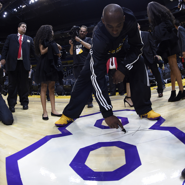 Kobe Bryant last game autographing court panel 8