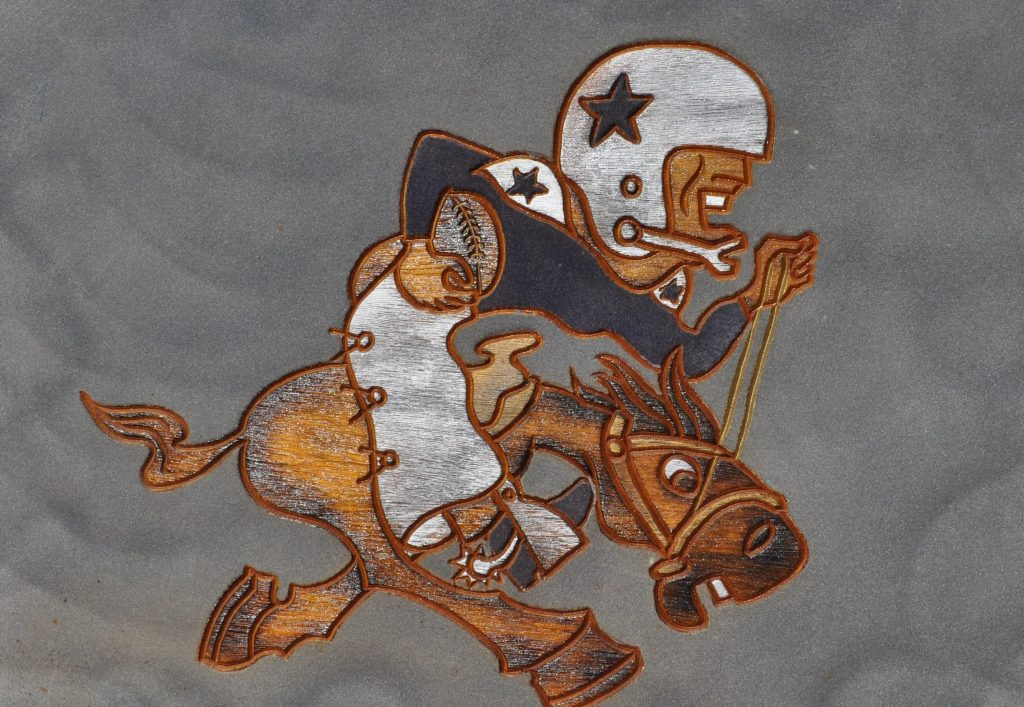 """""""Cowboy Joe"""" reflects the early history of the team."""