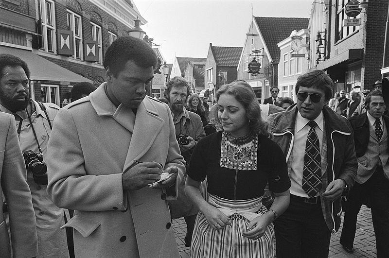 Muhammad Ali signing autographs 1960s