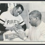 Roberto Clemente autographing baseballs 1971