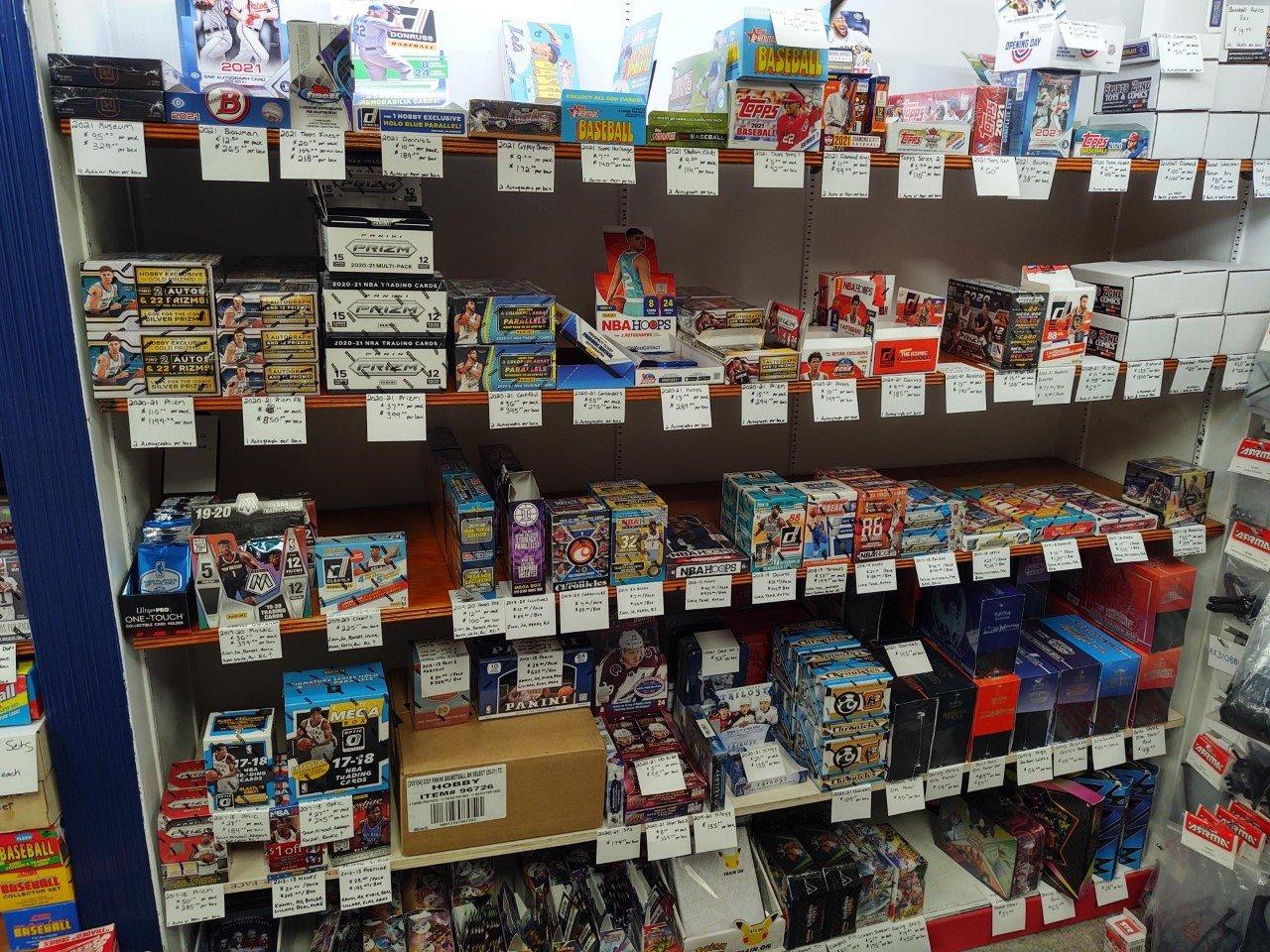 sports card boxes shelf